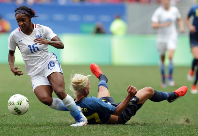 United States' Crystal Dunn dribbles past Sweden's Caroline Seger during a quarter-final match of the women's Olympic football tournament between the United States and Sweden in Brasilia Friday Aug. 12, 2016.(AP Photo/Eraldo Peres)