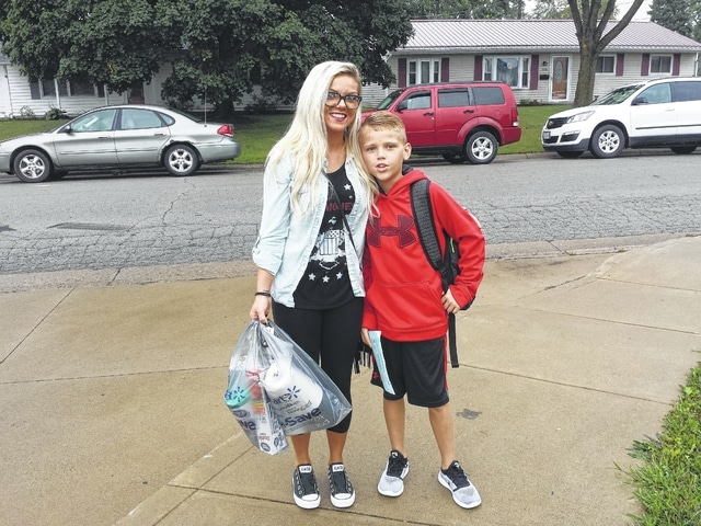 The Washington City Schools started the 2016-17 school year Wednesday with three of the four schools opening. Kirsti Bradley walks Belle Aire Intermediate fourth grader Kylan Walker to school Wednesday morning.