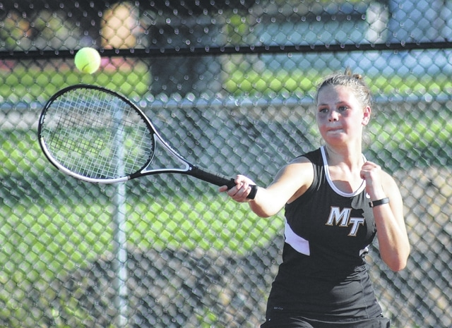 Miami Trace junior Cassie VanDyke hits the return during a second singles match against Hillsboro on the new courts at Miami Trace High School Tuesday, Aug. 30, 2016.