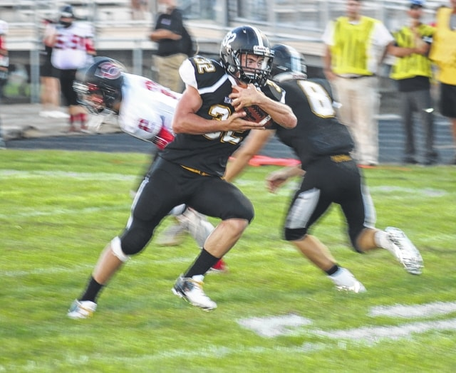 Drake Litteral crosses the goalline for Miami Trace for one of his three touchdowns on the night in a 51-12 routing of the Circleville Tigers Friday, Aug. 26, 2016 at Panther Stadium.