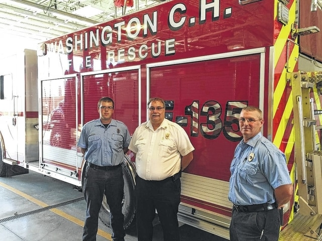 "The Washington C.H. Fire Department's newest, multi-functional fire truck will be in full service this Thursday. ""We will be doing training with the new truck the next couple of days so the guys know exactly how it works,"" said Tom Youtz, the chief of the Washington Fire Department. This truck - a 2014 Rosenbauer - was purchased from All-American Fire Equipment, a local company. According to Scott Monroe, of All-American Fire Equipment and also a part-time firefighter, there is a compartment at the front of the truck that will house two 100-foot hydraulic reels, a rescue pump, rescue tools, and up to 150 feet of pre-connected hand-line hose. This truck carries 1,000 gallons of water and features a 1,500-gallon-a-minute pump. The truck has a better turning ratio than ""141"" and has a shorter wheel base. Pictured are Matt Smith, Chief Tom Youtz, and Lt. Tim Downing."