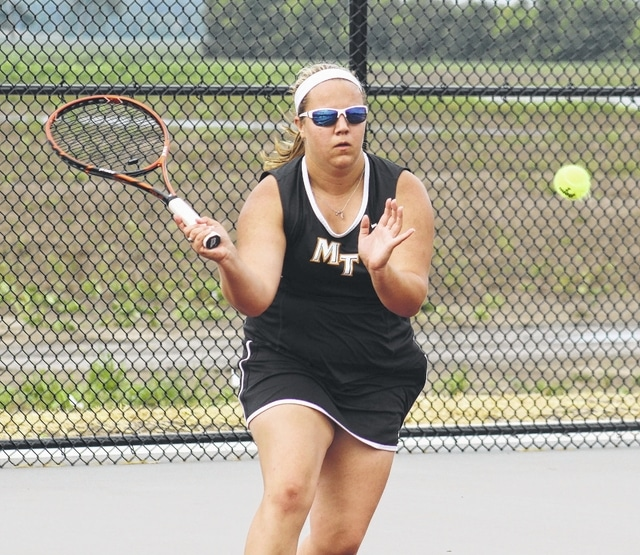 Miami Trace senior Macy Detty moves in to make the volley during an SCOL first singles match against East Clinton on the new courts at Miami Trace High School Wednesday, Aug. 24, 2016.
