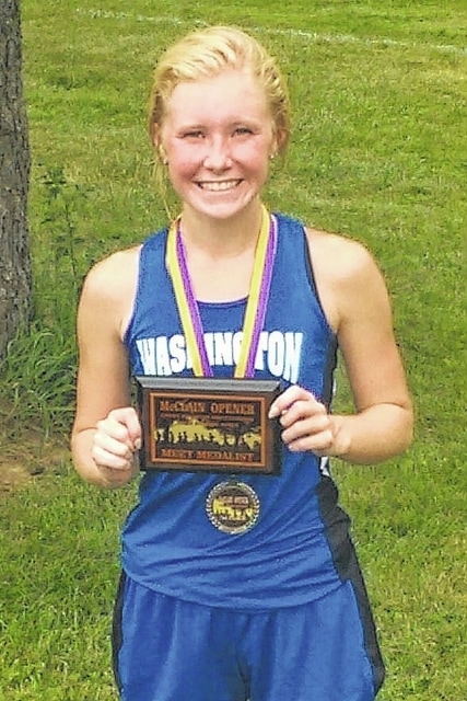 Washington's Maddy Garrison holds the plaque she received after winning the McClain season-opening meet held at Mitchell Park in Greenfield Wednesday, Aug. 24, 2016.
