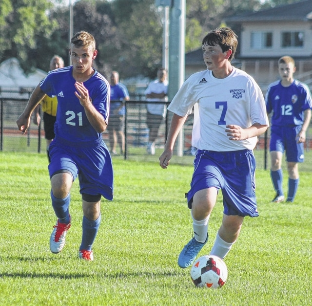 Washington's Max Schroeder (7) moves the ball toward the goal for the Blue Lions during an SCOL match, their home opener, at Washington High School Tuesday, Aug. 23, 2016.