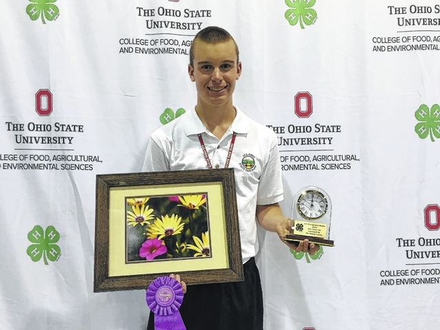 "Spencer Minyo, son of Buck and Debbie Minyo, won a clock trophy at the 2016 Ohio State Fair in the Photography Master category. He has taken several photography projects during his 4-H career and is proud to have achieved this goal. His photo will be displayed at the Nationwide & Ohio Farm Bureau 4-H Center on the Ohio State University Campus in the A.B. Graham Hall. The photo will also be on display at the 2017 Ohio State Fair. This is the second photo Minyo has had chosen as one of the ""Select Twenty"" during his 4-H career. Minyo is a member of the Charm-n-Farm 4-H Club and is a junior at Washington High School."