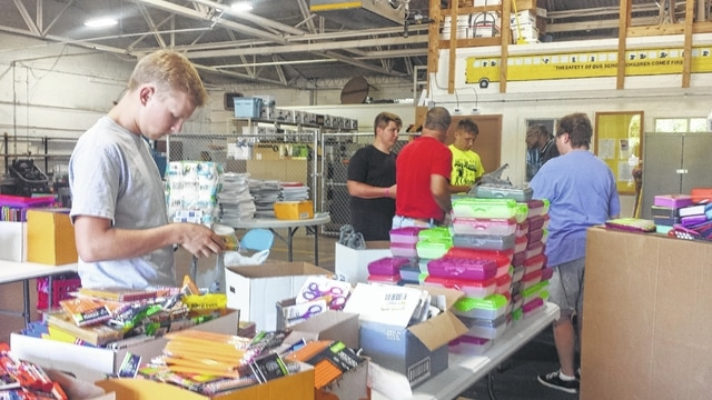 "Volunteers from the Miami Trace Key Club helped United Way of Fayette County sort the many donations of school supplies from the community and sponsors for the United Way's ""Stuff The Bus"" campaign."