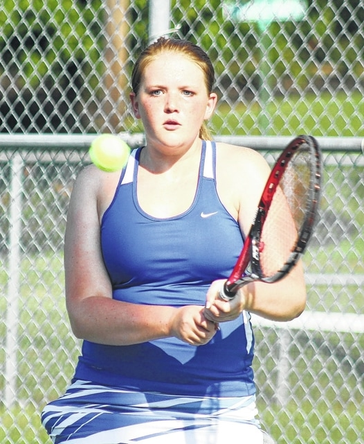 Washington freshman Sydnie Hall makes the return during a third singles match against Chillicothe at Gardner Park Thursday, Aug. 18, 2016 at Gardner Park.