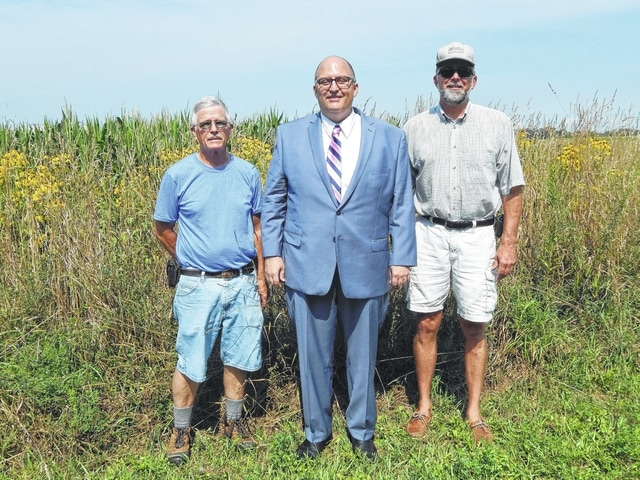Don Creamer, tree committee member, City Manager Joe Denen, and Bruce Willis, Tri-County Triangle Trail.