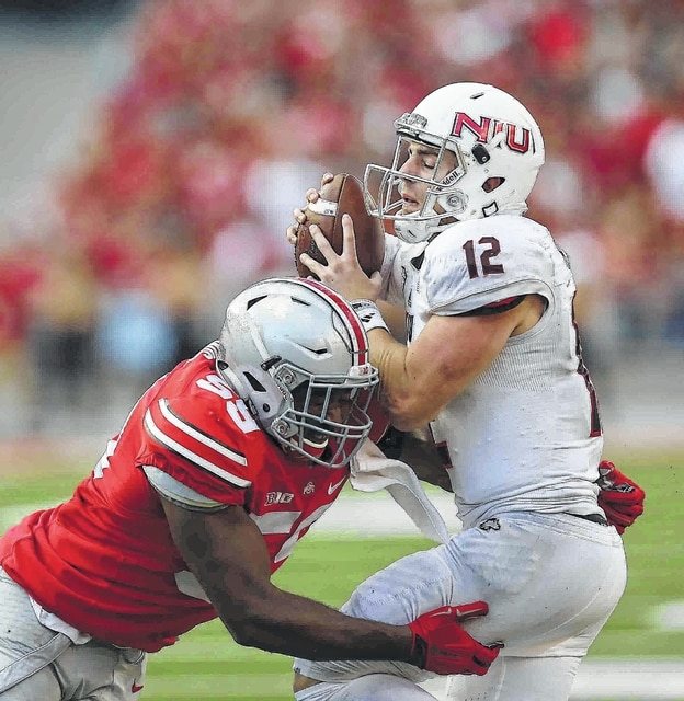 Ohio State defensive end Tyquan Lewis (left), one of only six returning starters for Ohio State, sacks Northern Illinois quarterback Drew Hare last season.