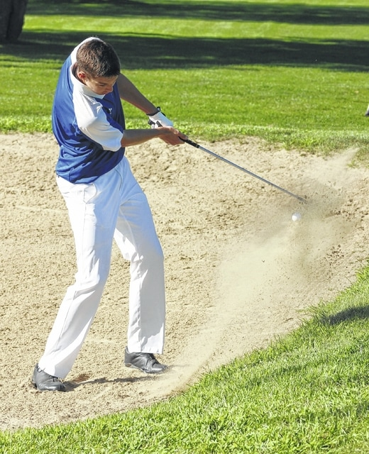 Washington senior Griffin Shaw chips out of a sand trap on the No. 6 hole during an SCOL quad match at the Club at Quail Run Tuesday, Aug. 23, 2016.