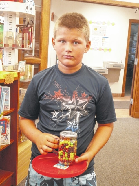 Calvin Miller was the latest winner of Miss Susan's Secret Sweets of Jeffersonville Branch Library. By guessing the correct number of Skittles in this jar, Calvin went home with the candy as well as the frisbie. Way to go Calvin!