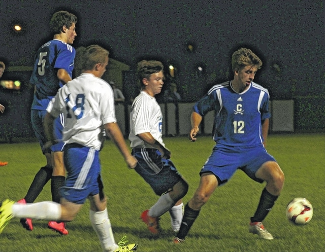 The Washington Blue Lions hosted Chillicothe for an SCOL match Tuesday, Sept. 20, 2016 at Washington High School. Pictured for the Blue Lions (l-r); Isaiah Barden (18) and Darion Strietenberger. Pictured for Chillicothe are; Matthew Detty (5) and Tanner Cutright (12).