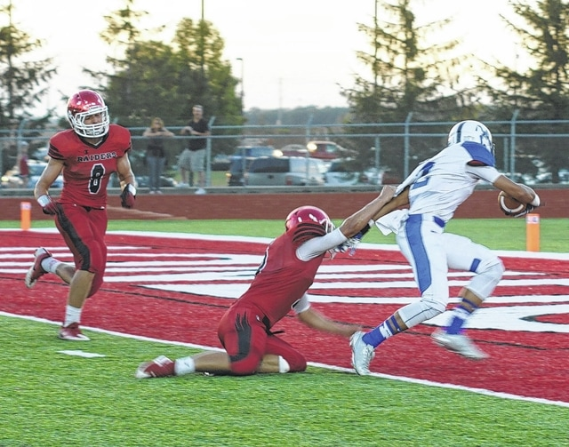 Dillon Steward of Washington drags a defender into the end zone for a touchdown during a non-league game at London High School Friday, Sept. 9, 2016.