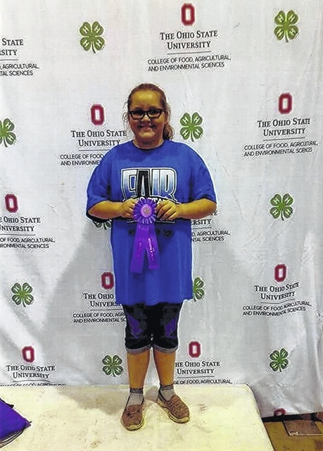 """Emma Miller, daughter of Rob and Kim Miller, received an outstanding of the day at the Ohio State Fair on July 27 with her """"Adventures In Home Living"""" project. Emma is a fifth grader at Belle Aire Intermediate and a member of the Packrat Crafters 4-H Club."""