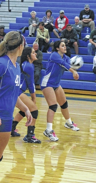 Jazzy Robinette, at right, passes the ball up to the front row for Washington during an SCOL match against Wilmington Thursday, Sept. 29, 2016 at Washington High School. Also pictured are (l-r); Victoria Jones and Susanna Eckstein.