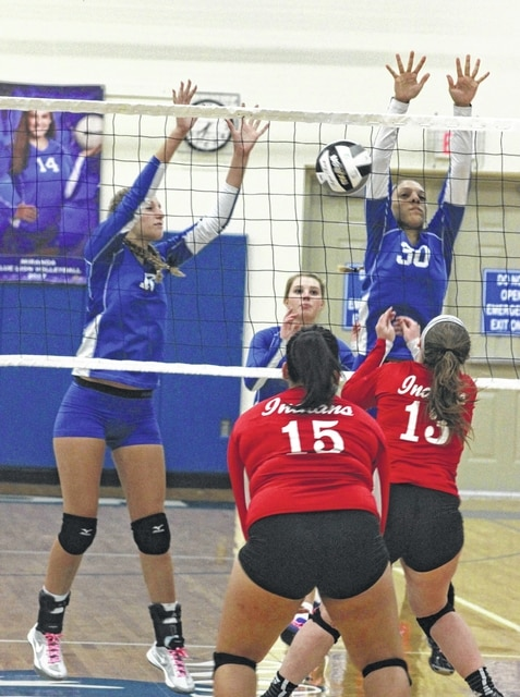 Faith Kobel (left) and Hannah Haithcock go up for the block for Washington during an SCOL match against Hillsboro Tuesday, Sept. 27, 2016 at Washington High School. Also pictured for Washington is Madalyn Wayne.