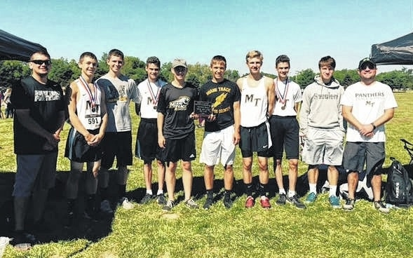 The Miami Trace boys cross country team placed third out of 12 teams at the Ohio Classic in Hillsboro Saturday, Sept. 3, 2016. (l-r); assistant coach Tyler Robertson, Nick Foody, Wyatt Cory, Henry DeBruin, Todd Peterson, Blake Pittser, Jake Atwood, Simon DeBruin, Cole Enochs and head coach Jeff Smallwood. Not pictured: Caleb Perry and Cody Burns.
