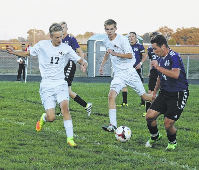 Miami Trace's Kody Burns (17) challenges a McClain player for the ball during an SCOL match at Miami Trace High School Tuesday, Sept. 27, 2016. Also pictured for the Panthers is Matt Fender. Burns scored late in the match to help secure a 2-0 Miami Trace win.