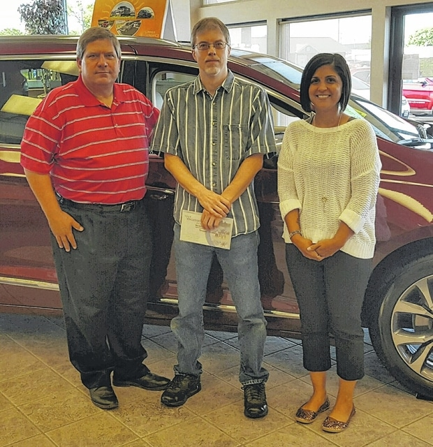 From left to right, Doug Marine, owner of Doug Marine Motors, winner Jody Edwards, and Record-Herald sales consultant Brandy Knisley.