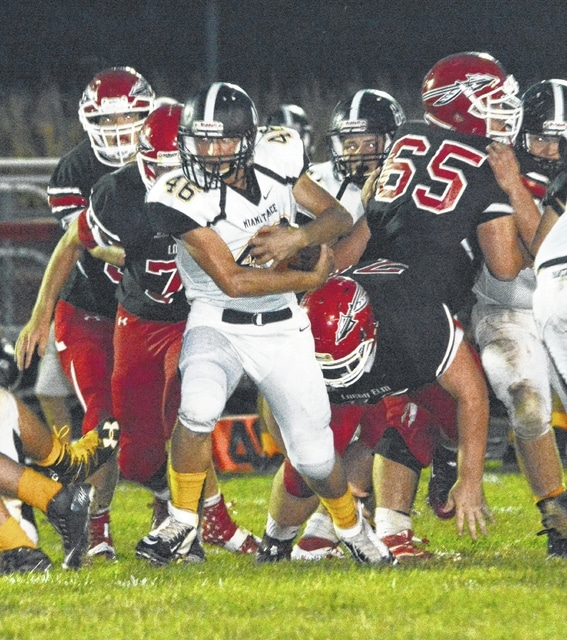 Trevor Moore (46) carries the ball for Miami Trace during a non-league game at Logan Elm High School Friday, Sept. 9, 2016.