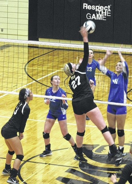 Miami Trace's Samantha Ritenour (27) makes the hit during an SCOL match against Washington Tuesday, Sept. 13, 2016 at Miami Trace High School. Also pictured for Miami Trace is Kennedy Campbell. Pictured for Washington are (l-r); Halli Wall, Madalyn Wayne and Victoria Jones.