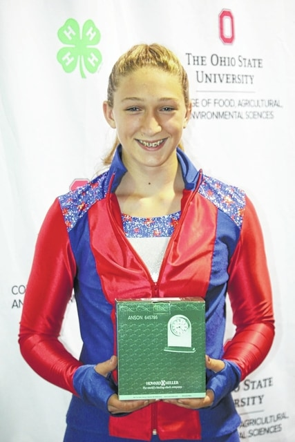 "Victoria Waits, of Washington Court House, won ""Outstanding of the Day"" and a clock trophy at the 2016 Ohio State Fair in the active sportswear category. Waits is a member of Perry Peppy Farmers 4-H Club and is a ninth grader at Miami Trace High School. Waits is the 14-year-old daughter of Daryl and Kris Waits."