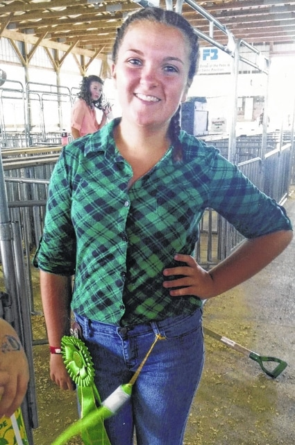 Haley Davis, 13-year-old member of the 4-H Barn Busters club, claimed fifth place in her swine showmanship class and market hog class.