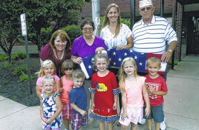 The VFW Post 3762 donates flags to the Fayette Progressive School. Pictured (L to R): Brenda Whitmer, Trish Thibert, Jamie Bryant and Sheldon Litton. They are pictured with kids from the school.