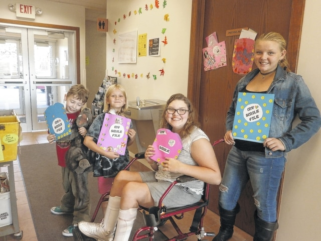 In honor of World Smile Day, Miss Bonnie of Jeffersonville Branch Library hosted a Create a Smile File Workshop for when you just feel a little down; you can turn that frown upside down. Among those participating were Michael, Jeslin, Riley and Ashtin.