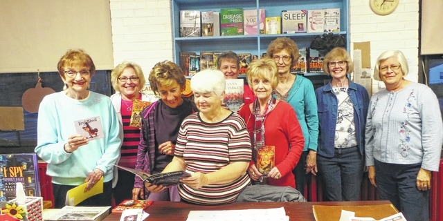 "The ""Book Chicks,"" a book club dating back to October 2003 and thus the first of several book clubs made up of local members of the female teachers honorary Delta Kappa Gamma, gathered for its 13th-anniversary October meeting in the New Holland Community Library. The library had been the brainstorm more than five years ago of Ginger Shipley and Book Chicks member Peggy Lester, and continues to serve patrons on Thursday and Saturday early-afternoons in the former New Holland Elementary School. Showing their love of books are (from left) Alma Litten, Patty Ondrus, Cindy Sagar, Peggy Lester, Norma Kirby, Sandy Sowash, Vicki Lynch, Jean Ann Davis and Debbie Roby."