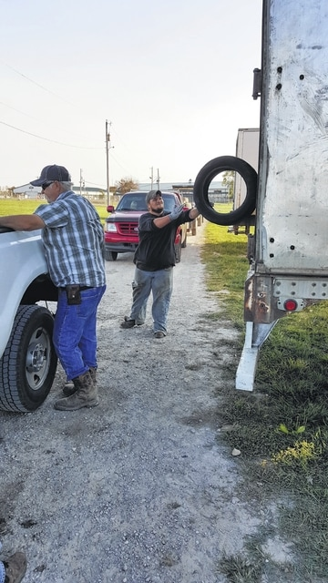 Workers unload some of the 5,421 tires collected during Fayette SWCD's Scrap Tire Amnesty.