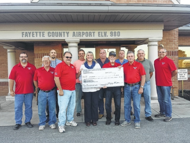 Fayette County Pilots & Friends donated $3,000 to Kamp Dovetail on Thursday evening thanks to a successful Runway Run held at the Fayette County Airport recently. Kamp Dovetail is a summer camp for handicapped children, where each person is specially cared for while enjoying the usual summer camp fun such as fishing, horseback riding, boat rides and crafts.