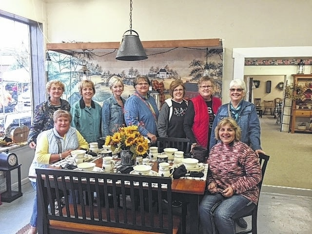 From left to right at The Lloyd Co.: seated, Kendra Knecht and Shirley Pettit, back row, Marty Cook, Rita Lanman, Emily King, Joyce Schlichter, Jeanne Miller, Judy Gentry and Julie Schwartz.
