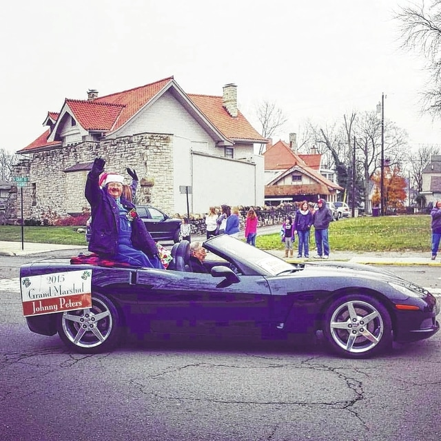 The 2015 Grand Marshal Johnny Peters waves to the crowd. Nominations for the 2016 holiday parade grand marshal are now being accepted and applications are available online or at the Fayette County Chamber of Commerce office.