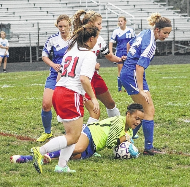 Jaelyn Mason makes a save for Washington during a Division II Sectional tournament match at Circleville Tuesday, Oct. 18, 2016. Also pictured for Washington are (l-r); Kayla Kimmet, Mackenzie Shaffer and Carly Dodds.