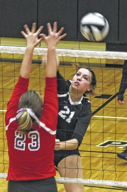 Miami Trace senior Kylie Reisinger (21) hits the ball past a player from Clinton-Massie during an SCOL match at Miami Trace High School Tuesday, Oct. 4, 2016.