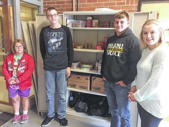 Amber Brown and Blake Mingua, members of the MTHS WE Can Club, are pictured with Jack (BJ) Anders and Maddi Wallace, MT FFA members, in front of one of four cabinets that comprise the Panther Pantry at MTHS. The Panther Pantry provides free and discreet access to food, clothing and hygiene supplies to students in need.