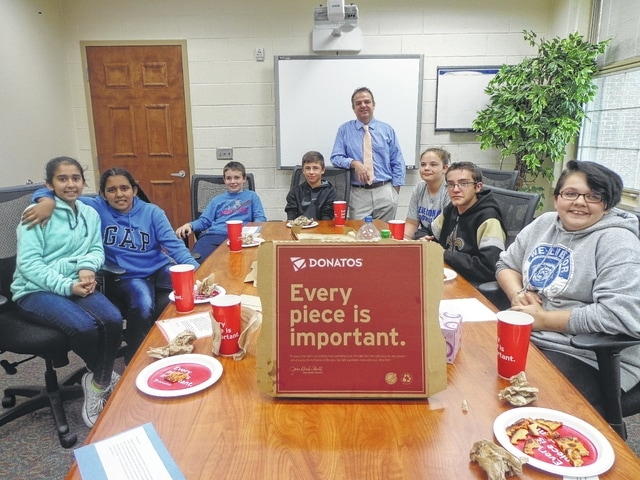 """Donatos recently provided pizza to these students at Washington Middle School as they celebrated """"Pizza with the Principals."""" This is in appreciation for their selection as Students of the Month for September. They are chosen by their teachers because of the outstanding example they set for their peers in such areas as academic effort, good work ethic, kindness to others, and service to their school. Pictured from left: Navneet Kaur, Harmanpreet Kaur, Ethan Westendorf, Karson Runk, Mr. Montgomery, assistant principal, Emily Becker, Devin Ison, and Emily Jacobs. Absent from picture Nakhia Pacheco-Vasquez."""