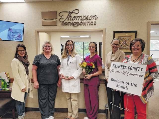 "The Chamber recently honored Thompson Orthodontics as its ""Business of the Month."" Sarah J. Thompson, DDS, is pictured in the center."