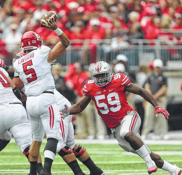 OSU's Tyquan Lewis, No. 59 (right), prepares to hit Rutgers QB Chris Laviano (No. 5) in the first quarter at Ohio Stadium on the campus of The Ohio State University October 1, 2016.