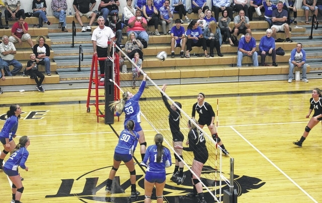 Washington's Delaney Greer (left) hits the ball over the net during a Division II Sectional semifinal match at Miami Trace High School Wednesday, Oct. 19, 2016. Also pictured for Washington are (l-r); Susanna Eckstein, Halli Wall, Hannah Haithcock and Miranda Landis. Picture for Miami Trace (l-r); Taylor Dawson, Samantha Ritenour, Ashley Campbell and Clare Sollars.