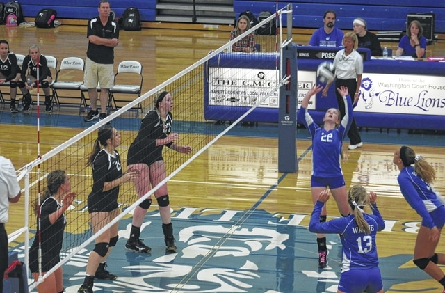 Halli Wall (22) sets the ball for Washington during an SCOL match against Miami Trace Thursday, Oct. 6, 2016 at Washington High School. Also pictured for Washington is Madalyn Wayne (13) and Hannah Haithcock. Pictured for Miami Trace are (l-r); Clare Sollars, Kylie Reisinger and Samantha Ritenour.
