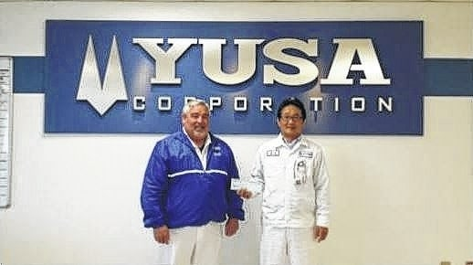 Pictured are Paul Grubb, vice president of administration, and Yukimitsu Minamibata, president and CEO of YUSA.