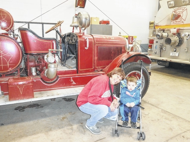 In keeping with the October theme of Fire Prevention Month, Miss Bonnie's Story Hour from Jeffersonville Branch Library visited Jeffersonville's Fire Department with firefighter Devon Jenkins leading a grand tour of all the fire engines. The oldest one, from 1927, is shown here with Cindi Grover (GG) and her grandson Zander.