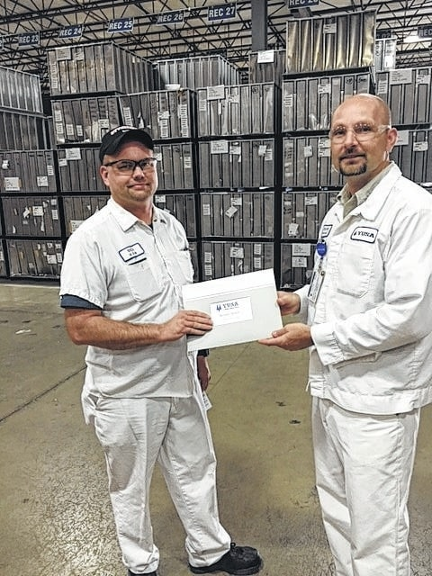Rich Reisch (left) of YUSA Corporation recently received an award for 25 years of service. Duane Shipley, vice president, presented Rich with his award.