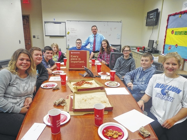 "Donatos recently provided pizza to these students at Washington Middle School as they celebrated ""Pizza with the Principals."" This is in appreciation for their selection as Students of the Month for November. They are chosen by their teachers because of the outstanding example they set for their peers in such areas as academic effort, good work ethic, kindness to others, and service to their school. Pictured from left: Destanie Leach, Hartley Larch, Caden Shiltz, Kascidy Carter, Dakota Oyer, Mr. Montgomery, assistant principal, Rachel Palmer, Preston Hines, Braden Penwell and Kassie Wiseman."