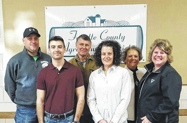 The sponsors for the Dec. 31 New Year's Eve Party with McGuffey Lane visited the Mahan Building recently to be recognized for their contribution. Pictured (L to R): front row: Andy Daniels with The Print Shop, Grace Kerns with Parrett Insurance and Tami Johnson with Vermeer. Back row: Bruce Collins with Collins Septic, Wayne Arnold with the senior fair board and Faith Cottrill with the senior fair board.