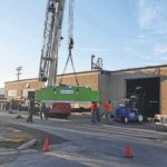 Delaware St. blocked as WCR moves in new machinery