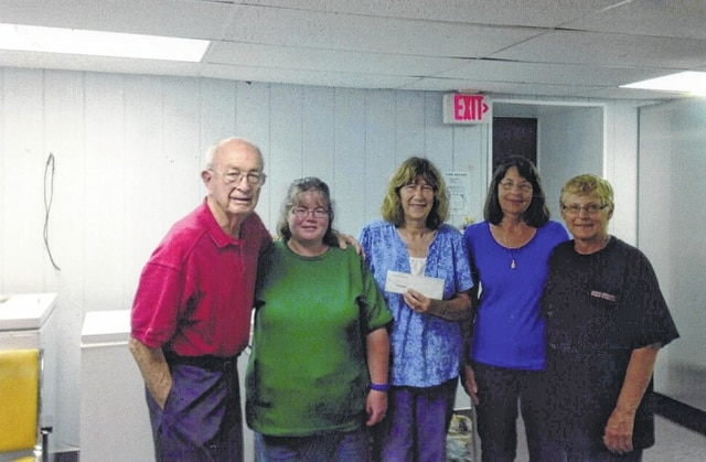 Royal Chapter #29, the Order of the Eastern Star in Washington Court House, recently made a donation to the Fayette County Food Pantry. Patti Havens of the Royal Chapter #29 presented a check to volunteers of the pantry. Pictured (L to R): Robert Heiny, Joyellen Pickelheimer, Havens, Wanda Link and Pam Heath. If someone is looking for a way to help others, and wants to have a great time in the process, consider membership in the Order of the Eastern Star, where fun and fellowship with people who want to give back to the community can be found. For more information call Havens at (740) 335-7135.