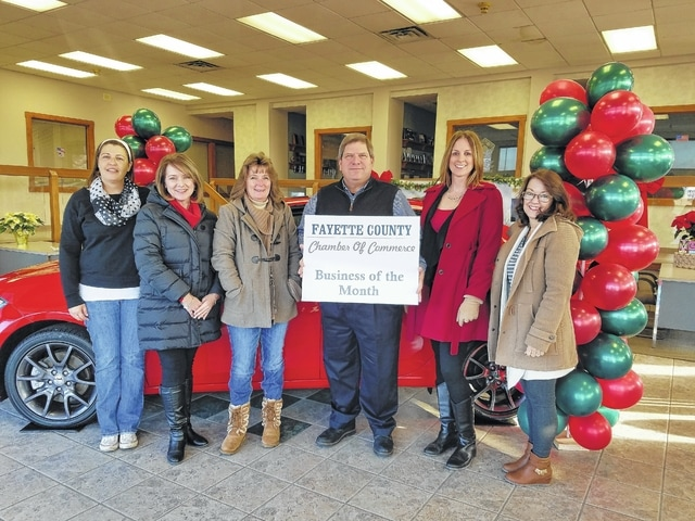 Doug Marine poses with the Fayette County Chamber Ambassadors. Doug Marine Motors was chosen to be the December Business of the Month.